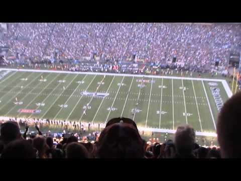 Raising the 12th Man flag, kicking off the 2014 NFL season
