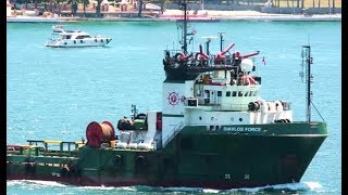 Offshore Supply Ship DIAVLOS FORCE tows a yacht at sea