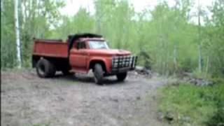Mater the dump truck climbing a rock filled hill