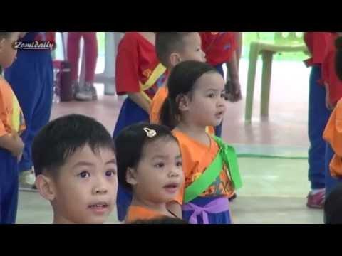Children sing Negaraku (National anthem of Malaysia)
