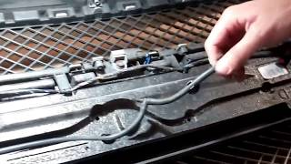 How to change the front grille on Jaguar XF 2011 on