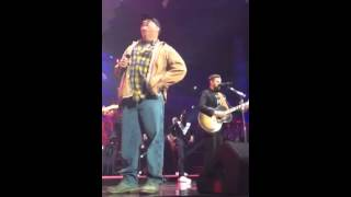 Front row Justin Timberlake and Garth Brooks singing low places in Na