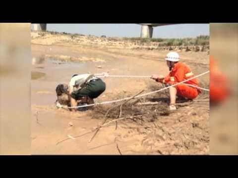 Raw: Woman Rescued From Mud in China