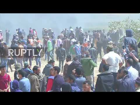 State of Palestine: Injured protesters carried away during Israel-Gaza border violence