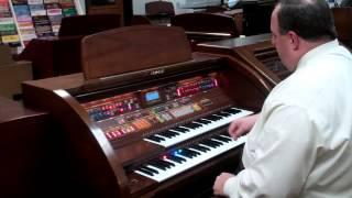 Beautifull Used Lowrey Premier w/ rolltop | Orem Piano Gallery