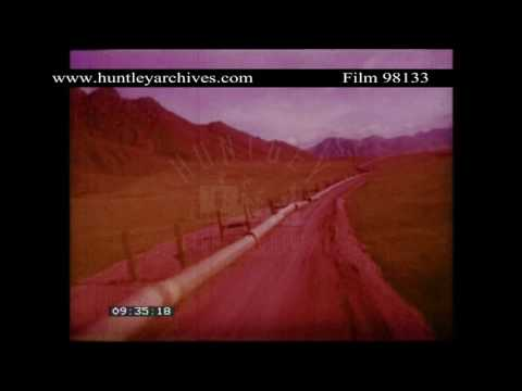 Oil pipeline under construction in Alaska in the 1970's.  Archive film 98133