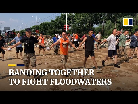 Thousands of residents in central China's Xinxiang city band together to fight rising floodwaters