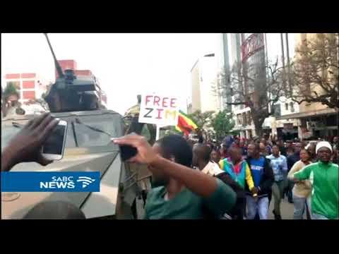 Zimbabweans celebrate the expected fall of President Mugabe