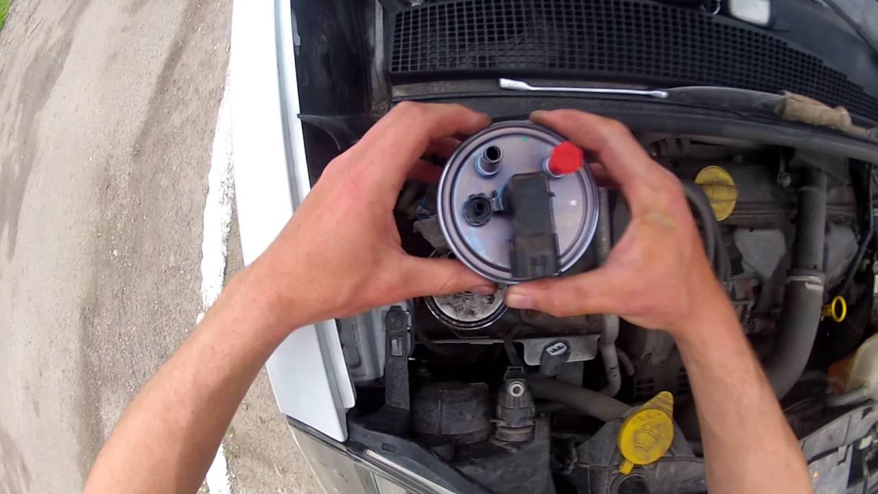 где находится топливный фильтр на renault symbol