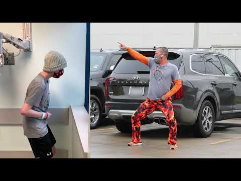 Dad-Dances-in-Parking-Lot-During-Sons-Cancer-Treatments