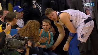 Luka Doncic autographs jersey for young fan after collision in game at Golden State