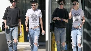 kristen stewart and girlfriend st vincent wear matching ripped jeans