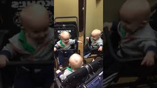 Baby Sees Three Reflections in Department Store Mirror 1045257