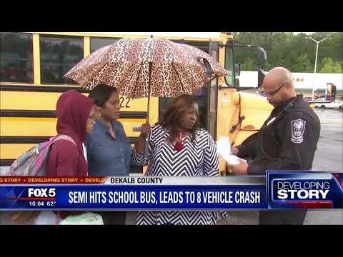 Semi hits school bus, leads to 8 vehicle crash