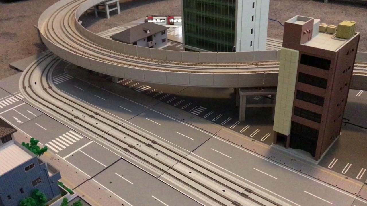 kato layout including a n700 shinkansen and a unitram  u65b0 u5e79 u7dda