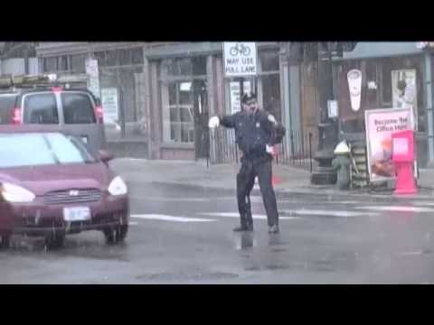 Watch this dancing cop bust a move