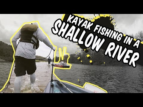 Kayak Fishing In A Shallow River