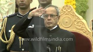 President Pranab Mukherjee stands for the National Anthem on R-Day in Delhi