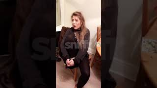Girl struggling to take her shoes off