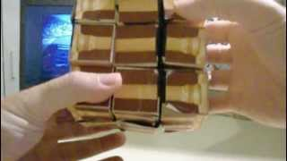 The Acropolis Cube, Precious Cube, Houlis Cube, and Kinky Cube (puzzles by Pantazis Houlis)