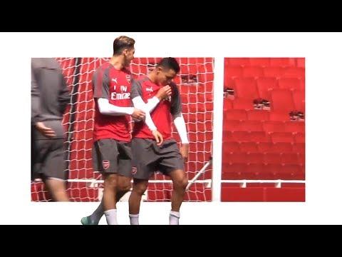 Alexis Sanchez Kisses Arsenal Badge During Open Emirates Training Session