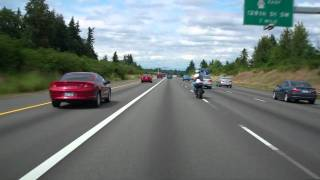 Sport Bike Popping Wheelie Getting on Freeway