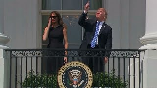 Donald Trump stares at the sun, without eye protection, during solar eclipse