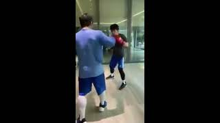 Manny Pacquiao does mitts workout with son
