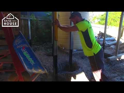 Pouring Concrete In Holes - House Raising Process