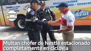 Multan a chofer de Nestlé estacionado completamente sobre ciclovía