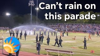 Arizona High School Marching Band Keeps Playing Despite Sprinklers