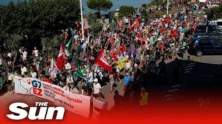 thousands-march-french-spanish-border-g7-summit