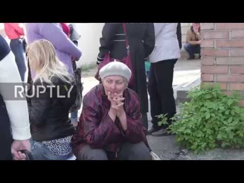Ukraine: Donetsk residents share hopes while queuing for Russian citizenship