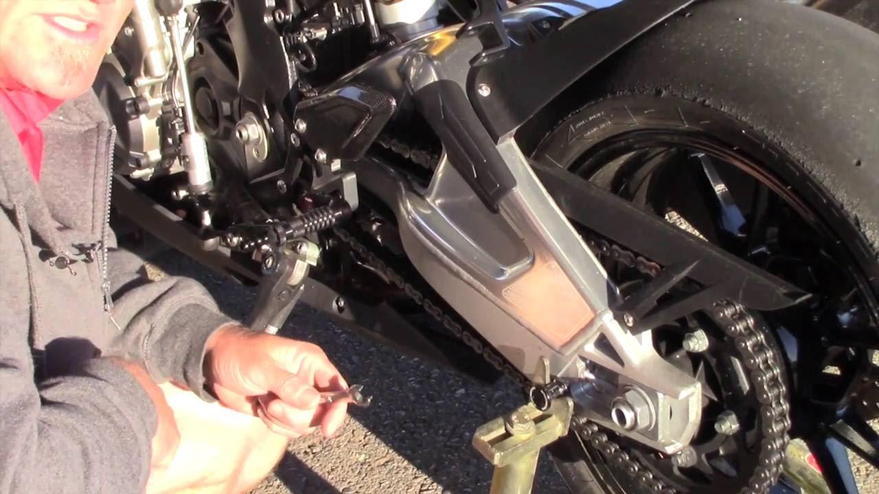 How To: Standard swingarm chain adjustment - YouTube