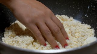 Shot of Indian woman mixing milk and flour to make the dough - Diwali sweets