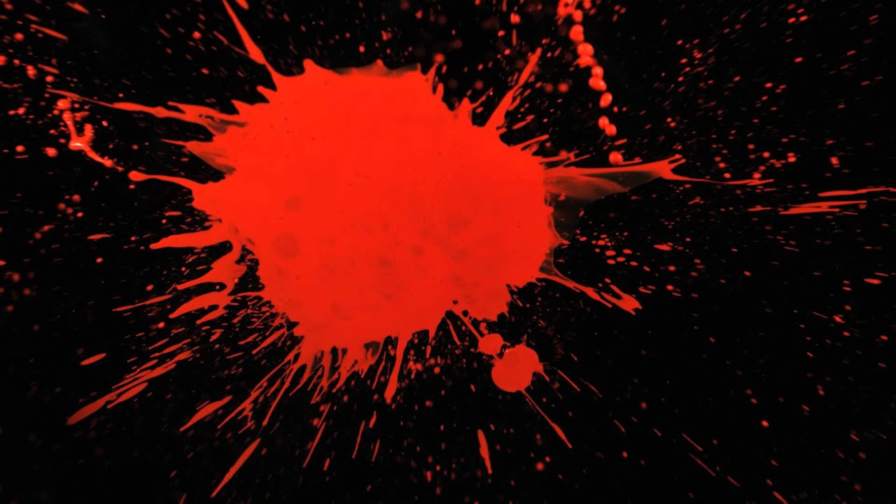 Slow Motion Paint Splatter with Red Paint Splattering a ...