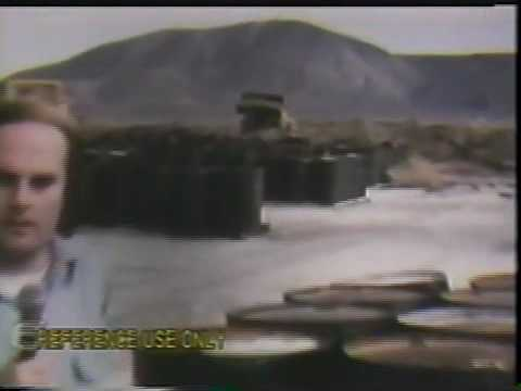 Bulldozers puncture drums of toxic waste at Alkali Lake, Oregon