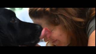 Dog kissing booth cąm shows pooch's smooches in slo-mo