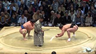Sumo Wrestler Throws Opponent Out of Ring