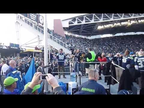 Steve Largent raises the 12th man flag at Century Link Field - Seattle Sehawks