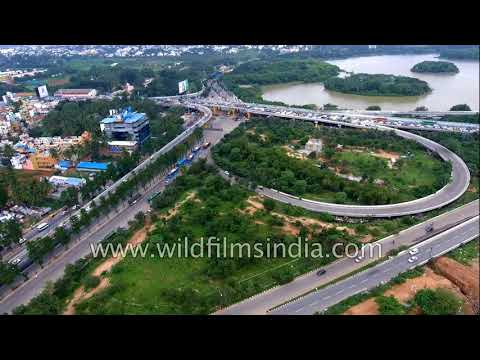 Bangalore clover-leaf flyover, new city skyline, parks and IT city Whitefield : aerial journey