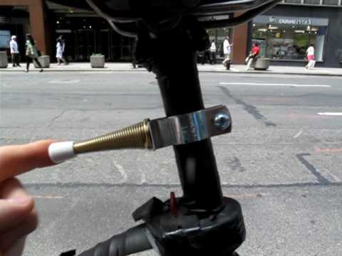 Spring Door Stop Mounted On Bicycle For Stupid Amusement!