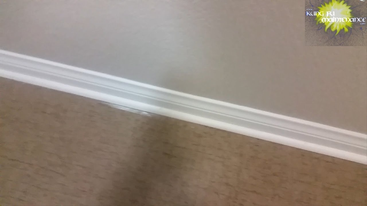 Dried Paint Over Run From Baseboard Onto Vinyl Flooring