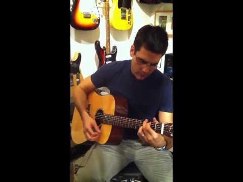 Ben Bass strums the guitar