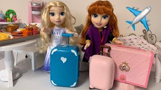 Elsa and Anna toddlers Packing for Vacation Disney Princess