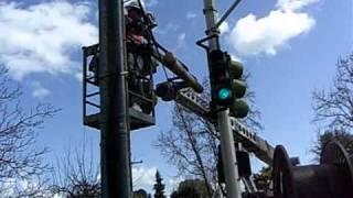 AT&T U-verse team pulls fiber cable via hanging conduit, for DSL Internet & TV  service