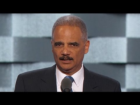 Former U.S. Attorney General Eric Holder addresses the DNC
