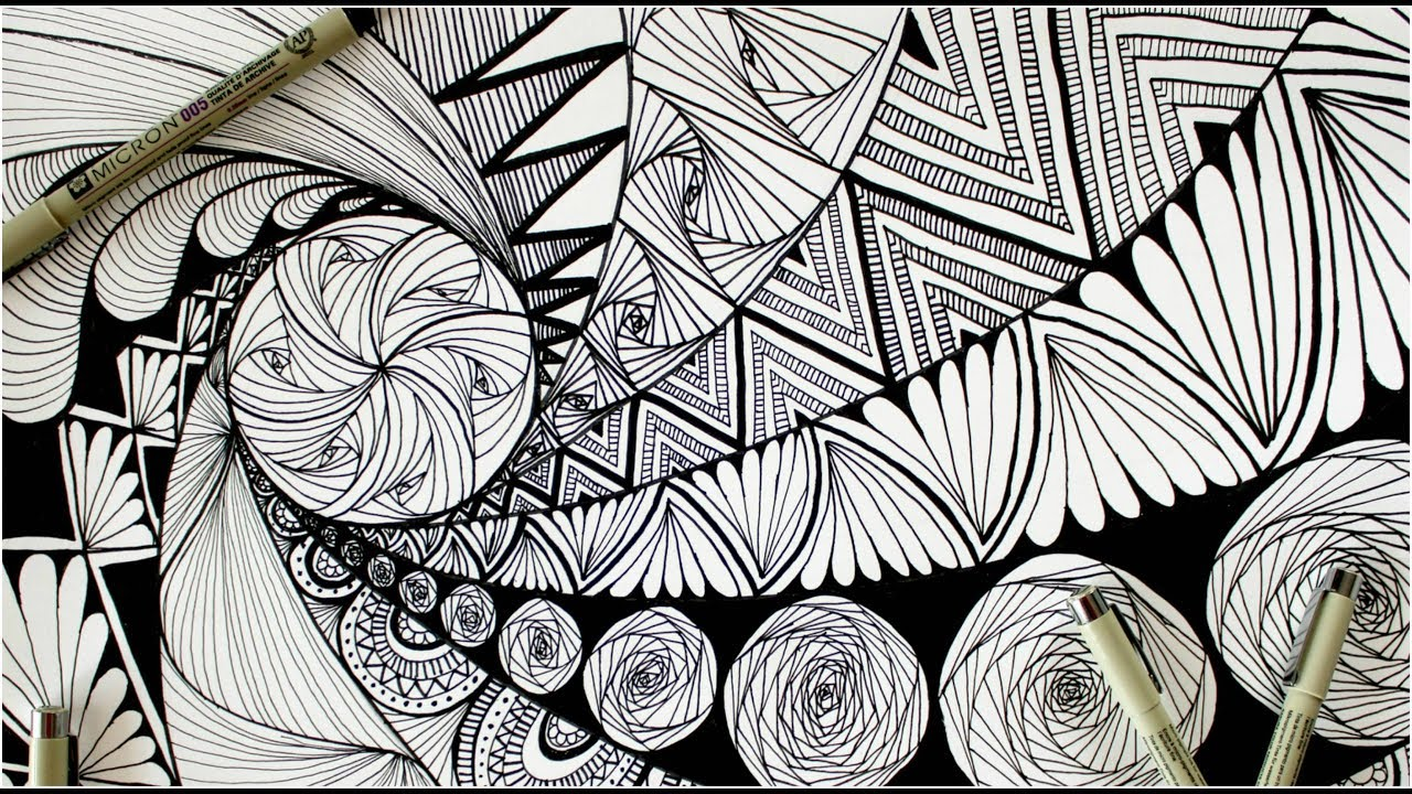 Black and white drawing of a design called Zentangle; two pens laying on artwork