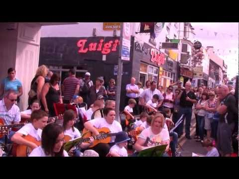 "CAVAN FLEADH 2012   Amanda and her students with guitars sing ""Dublin rare oul times'"