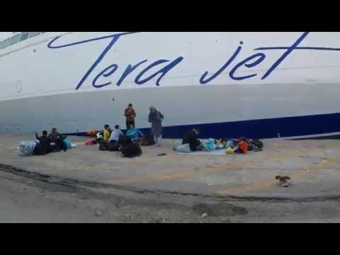 Exodus - Migrants boarding a ferry in Lesbos/Greece